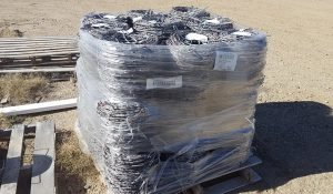 Rolls of Barbed wire fencing materials available at Moses Building Center